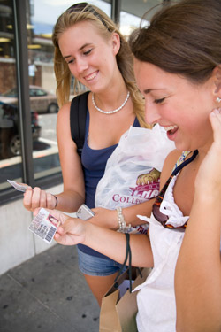 Students looking at their Cougar Cards